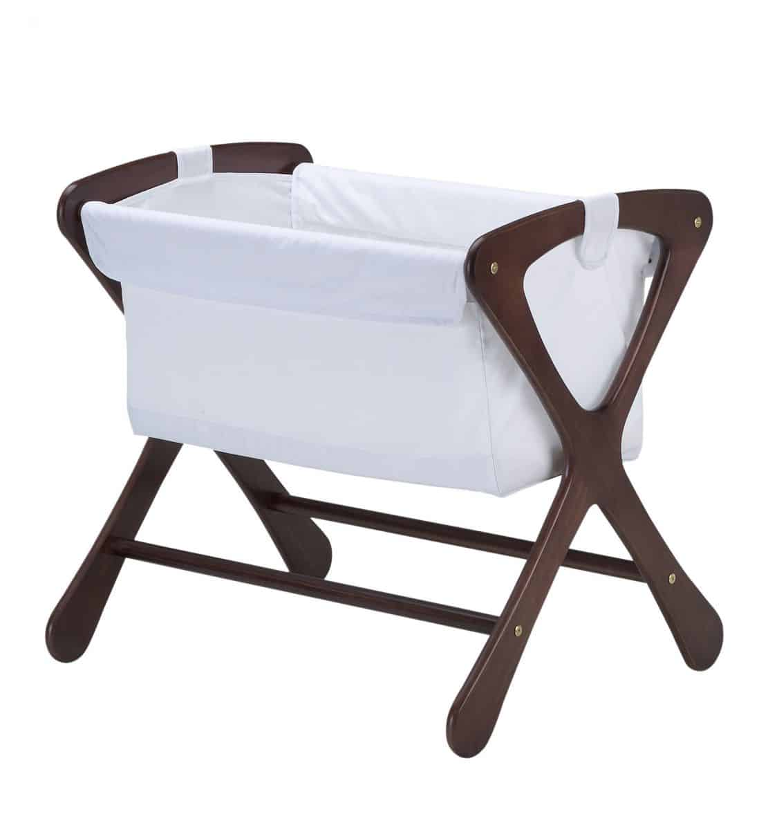 hello wonderful   modern baby bassinets - cariboo bassinet  made of new zealand timber with modern curveddesigns in four different classsic finishes that will fit into anycontemporary home