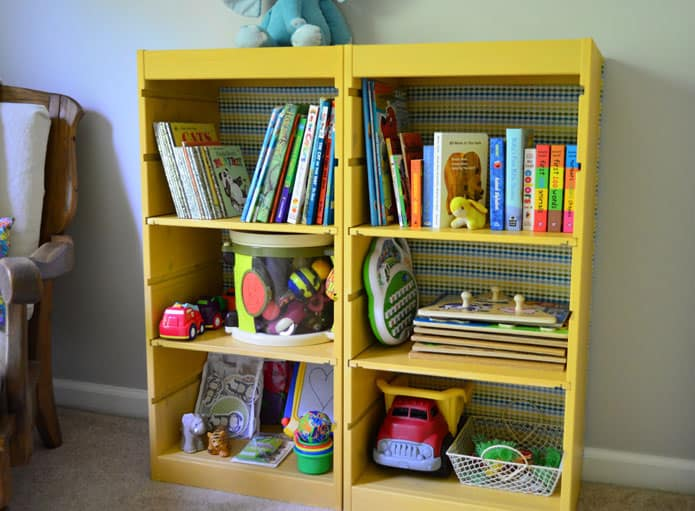 Colorful Bookcase (via Plumfield Shop) Paint and fabric turn a plain  bookcase into a bright and playful showcase. - Hello, Wonderful - 10 CREATIVE IKEA HACKS FOR KIDS' ROOMS