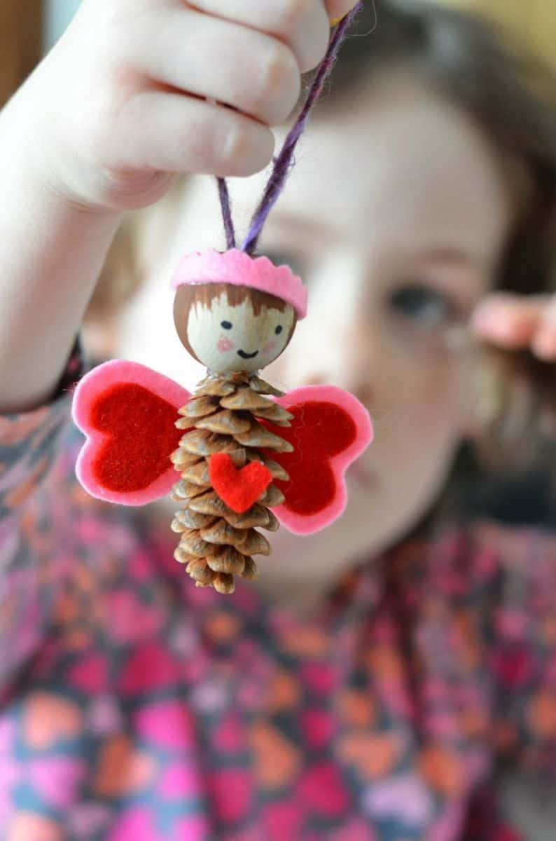 pine cone fairies via twig and toadstool turn pine cones